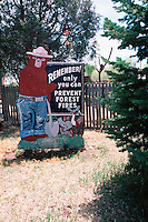 A fire prevention sign featuring Smokey the Bear, reading 'Remember! Only You Can Prevent Forest Fires'. Smokey Bear State Historical Park, Capitan, New Mexico.