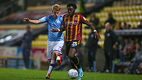 Sammy Robinson of Man City and Aramide Oteh of Bradford City during the The Leasing.com Trophy match between Bradford City and Manchester City U21 at the Utilita Energy Stadium, Bradford, England on 24 September 2019. Photo by Thomas Gadd.