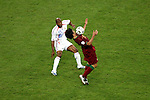 05 July 2006: Deco (POR) (right) executes the chest trap in front of Sylvain Wiltord (FRA) (11). France defeated Portugal 1-0 at the Allianz Arena in Munich, Germany in match 62, the second semifinal game, in the 2006 FIFA World Cup.