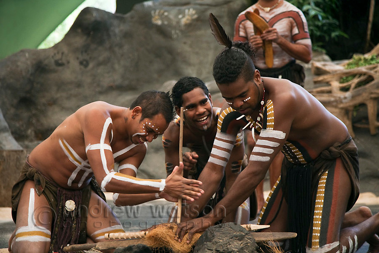 Indigenous performers using traditional methods to make fire at Tjapukai Aboriginal Cultural Park.  Smithfield, Cairns, Queensland, Australia