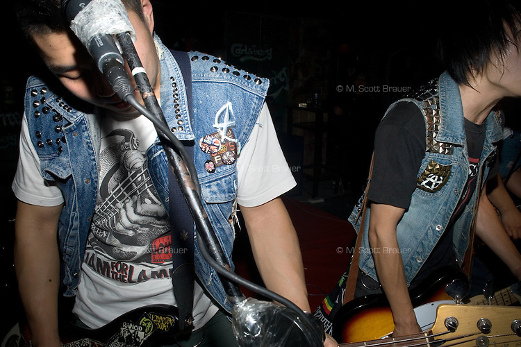 A punk band performs at a concert at Castle Bar in Nanjing, China.