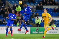 Bruno Ecuele Manga of Cardiff City heads back to goal under pressure from Jordan Hugill of Preston North End during the Sky Bet Championship match between Cardiff City and Preston North End at the Cardiff City Stadium, Cardiff, Wales on 29 December 2017. Photo by Mark  Hawkins / PRiME Media Images.