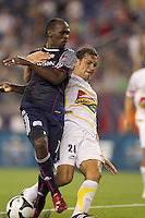 New England Revolution forward Kheli Dube (11) fails to connect as Monarcas Morelia defender Mauricio Romero (26) defends. The New England Revolution defeated Monarcas Morelia in SuperLiga 2010 group stage match, 1-0, at Gillette Stadium on July 20, 2010.