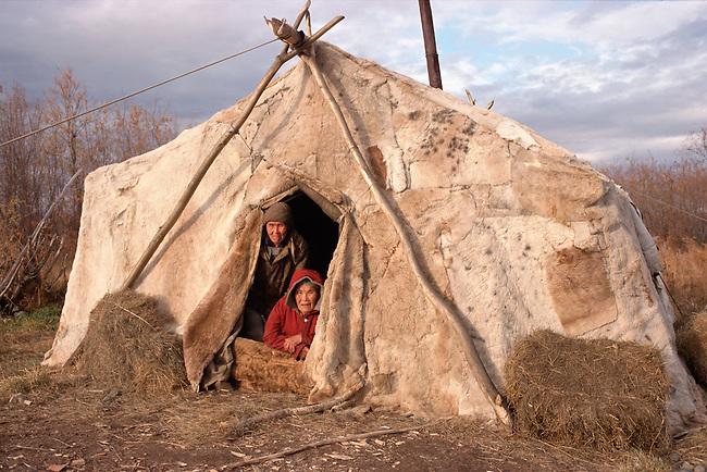 Two Chukchi women in a reindeer skin tent at a camp near Khailino.Koryakia, Kamchatka, Siberia, Russia.