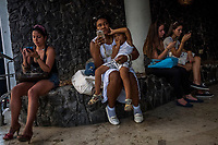 HAVANA, CUBA - SEPTEMBER 08: Cubans gather on Rampa to connect to Wifi available from the street on the 8th of September, 2015 in Havana, Cuba. <br /> <br /> Daniel Berehulak for The New York Times