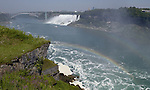 Niagara Falls, Ontario, Canada - 01 August 2006---Rainbow on the Niagara River with the American Falls, on the United States' side, and the Rainbow (International) Bridge---nature, landscape, infrastructure---Photo: © HorstWagner.eu