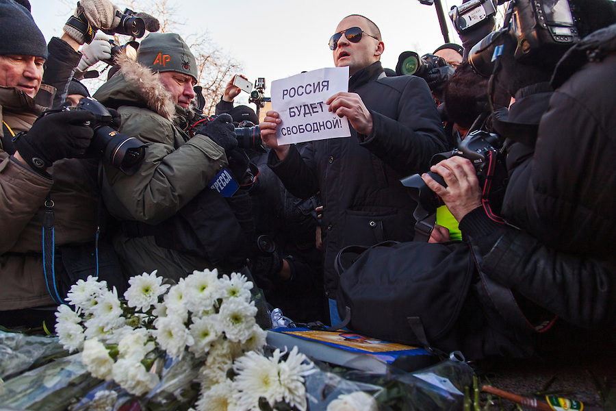 Moscow, Russia, 15/12/2012..Opposition leader Sergei Udaltsov holds a poster reading ?Russia will be free? by a memorial to KGB victims in Lubyanka Square at an unauthorised opposition rally to mark a year of protests against Vladimir Putin.