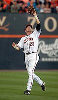 Virginia outfielder Derek Fisher (23) makes a catch during the game against Arkansas Saturday night at Davenport Field in Charlottesville, VA. Photo/The Daily Progress/Andrew Shurtleff
