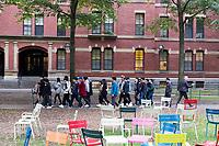 People walk in front of Weld Hall, a freshman dorm in Harvard Yard, at Harvard University in Cambridge, Massachusetts, USA, on Mon., Oct 15, 2018.