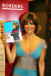 Lisa Rinna poses with her new book Rinnavation - Getting Your Best Life Ever as it debuts today, May 19. 2009 at Borders at Columbus Circle, New York City, New York. (Photo by Sue Coflin/Max Photos)