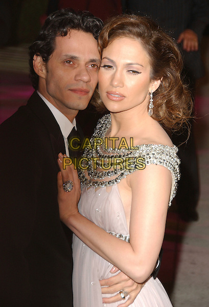 MARC ANTHONY & JENNIFER LOPEZ.The 2007 Vanity Fair Oscar Party Hosted by Graydon Carter held at Morton's, West Hollywood, California, USA, 25 February 2007..oscars half length pink Marc Jacobs dress married couple.CAP/ADM/GB.©Gary Boas/AdMedia/Capital Pictures.