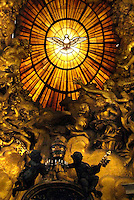 Particular,the Altar of the Chair of Saint Peter by Bernini,Vatican Basilica..The Cathedra Petri (Latin) or Chair of Saint Peter is a relic conserved in St. Peter's Basilica, Rome, enclosed in a gilt bronze casing that was designed by Gian Lorenzo Bernini and executed 1647-53..Above the throne in a stuccowork dorati radial surrounded by angels, is a finestrone of Fund in Alabaster depicting a dove (the wingspan is 162 cm), symbol (which, according to the Catholic doctrine, guide the successors of Peter in their job) Holy Spirit. It is the only stained glass colored the entire Basilica of Saint Peter..