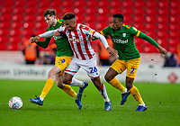 12th February 2020; Bet365 Stadium, Stoke, Staffordshire, England; English Championship Football, Stoke City versus Preston North End; Tyrese Campbell of Stoke City is tackled by Tom Barkhuizen and Darnell Fisher of Preston North End