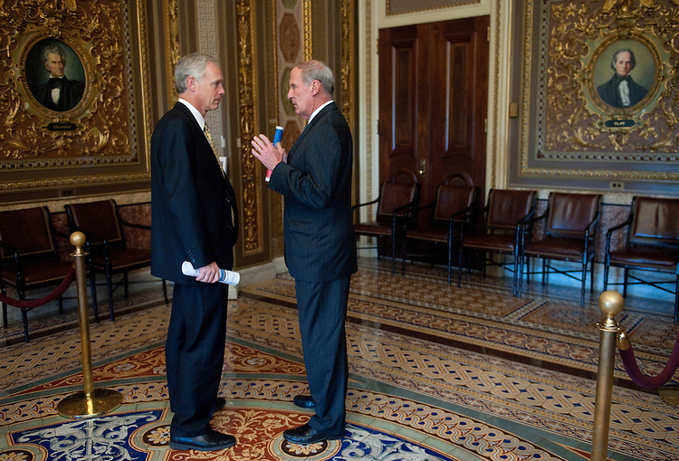 UNITED STATES - JULY 26: Sen. Ron Johnson, R-Wisc., left, and Sen. Dan Coats, R-Ind., talk in the Senate Reception Room following the Senate Repubicans' policy lunch on Tuesday, July 26, 2011. (Photo By Bill Clark/Roll Call)