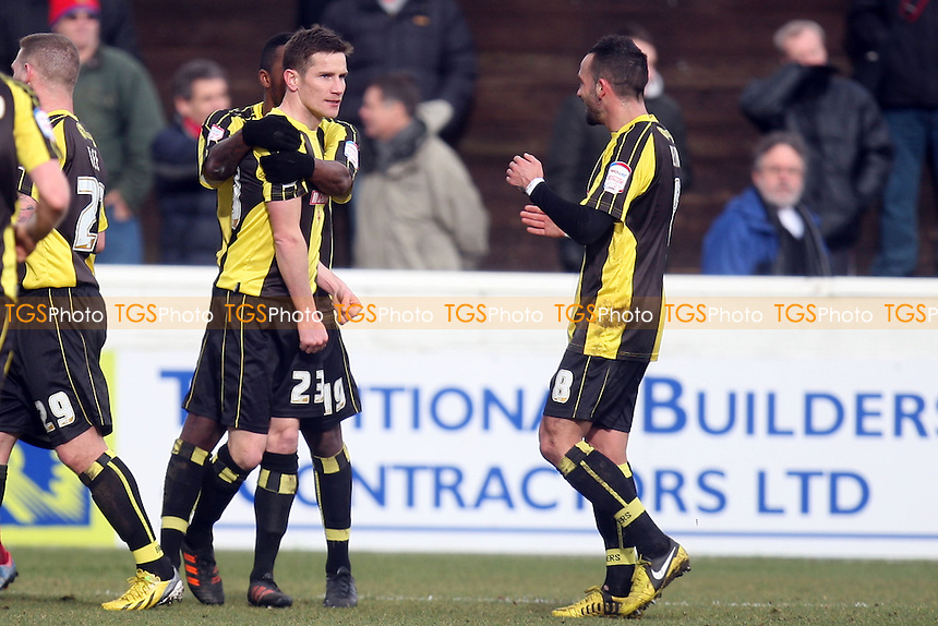 Lee Bell of Burton Albion (23) is congratulated after scoring the opening goal - Dagenham and Redbridge vs Burton Albion at the London Borough of Barking and Dagenham Stadium - 16/03/13 - MANDATORY CREDIT: Dave Simpson/TGSPHOTO - Self billing applies where appropriate - 0845 094 6026 - contact@tgsphoto.co.uk - NO UNPAID USE.