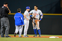 St. Lucie Mets outfielder Gilbert Gomez #17 talks with coach Ryan Ellis and the team trainer after sliding into second during a game against the Bradenton Marauders on April 12, 2013 at McKechnie Field in Bradenton, Florida.  St. Lucie defeated Bradenton 6-5 in 12 innings.  (Mike Janes/Four Seam Images)