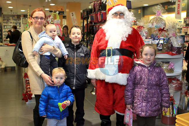Cian, Aisling, Conor, Ronan and Sandra Crinion with Santa at the Christmas Customer Day in the Cottage Pharmacy 2011...(Photo credit should read Jenny Matthews www.newsfile.ie)....This Picture has been sent you under the conditions enclosed by:.Newsfile Ltd..The Studio,.Millmount Abbey,.Drogheda,.Co Meath..Ireland..Tel: +353(0)41-9871240.Fax: +353(0)41-9871260.GSM: +353(0)86-2500958.email: pictures@newsfile.ie.www.newsfile.ie.