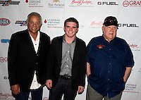Aug. 29, 2013; Avon, IN, USA: NHRA NHRA former drivers Don Prudhomme  (left) IndyCar driver Conor Daly (center) and Tom McEwen on the red carpet prior to the premiere of Snake & Mongoo$e at the Regal Shiloh Crossing Stadium 18. Mandatory Credit: Mark J. Rebilas-