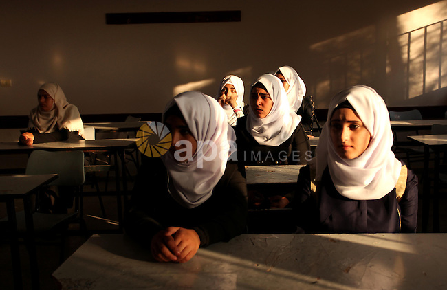 Palestinian schoolgirls attend a lesson in a classroom on the first day of a new school year, at a United Nations-run school in Khan Younis in the southern Gaza Strip August 28, 2016. Photo by Ashraf Amra