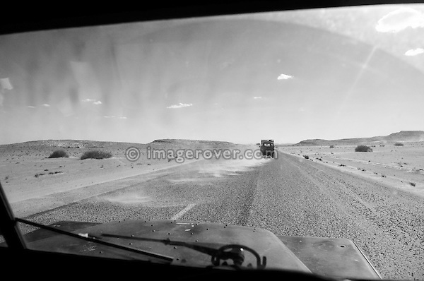 Africa, Tunisia, between Gafsa and Kebili. Two Historic Series Land Rovers driving across the Chott El Jerid. --- No releases available, but releases may not be needed for certain uses. Automotive trademarks are the property of the trademark holder, authorization may be needed for some uses.  --- Info: Image belongs to a series of photographs taken on a journey to southern Tunisia in North Africa in October 2010. The trip was undertaken by 10 people driving 5 historic Series Land Rover vehicles from the 1960's and 1970's. Most of the journey's time was spent in the Sahara desert, especially in the area around Douz, Tembaine, Ksar Ghilane on the eastern edge of the Grand Erg Oriental.