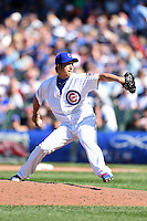 Chicago Cubs pitcher Kyuji Fujikawa (11) delivers a pitch during a game against the Milwaukee Brewers on August 14, 2014 at Wrigley Field in Chicago, Illinois.  Milwaukee defeated Chicago 6-2.  (Mike Janes/Four Seam Images)