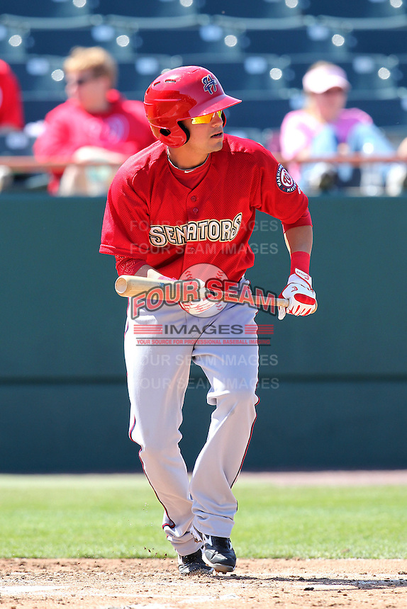 Harrisburg Senators third baseman Jose Lozada #7 looks to bunt during a game against the Bowie BaySox at Prince George's Stadium on April 8, 2012 in Bowie, Maryland.  Harrisburg defeated Bowie 5-2.  (Mike Janes/Four Seam Images)