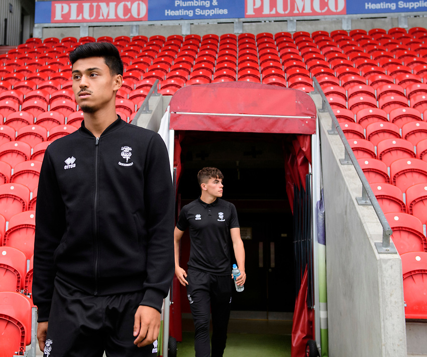 Lincoln City's Ziyad El-Oyouni arrives at the ground prior to the game<br /> <br /> Photographer Chris Vaughan/CameraSport<br /> <br /> EFL Leasing.com Trophy - Northern Section - Group H - Doncaster Rovers v Lincoln City - Tuesday 3rd September 2019 - Keepmoat Stadium - Doncaster<br />  <br /> World Copyright © 2018 CameraSport. All rights reserved. 43 Linden Ave. Countesthorpe. Leicester. England. LE8 5PG - Tel: +44 (0) 116 277 4147 - admin@camerasport.com - www.camerasport.com