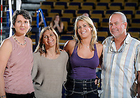 Florida International University retired women's volleyball player Yarimar  Rosa's number and her parents with Head Coach Danijela Tomic after the game against Western Kentucky University.  Western Kentucky won the match 3-0 on September 30, 2011 at Miami, Florida. .