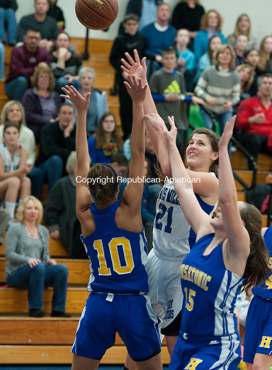 BURLINGTON, CT-011714JS06- Lewis Mills' Mikayla Penn (21) puts up a shot over Housatonic's Lauren Segalla (10) and Katie Heacox (15)  during their game Friday at Lewis S. Mills High School in Burlington. <br /> Jim Shannon Republican-American