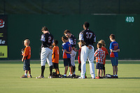 A group of young baseball players join Kannapolis Intimidators outfielders Landon Lassiter (2), Tyler Sullivan (5), and Micker Aldofo (37) on the field for the National Anthem prior to the game against the Delmarva Shorebirds at Kannapolis Intimidators Stadium on June 25, 2016 in Kannapolis, North Carolina.  The Intimidators defeated the Shorebirds 2-1.  (Brian Westerholt/Four Seam Images)