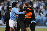 06 December 2008: North Carolina's Brooks Haggerty (in orange) is mobbed by teammates after the game. The University of North Carolina Tar Heels defeated the Northwestern University Wildcats 1-0 at Fetzer Field in Chapel Hill, North Carolina in a NCAA Division I Men's Soccer tournament quarterfinal game.