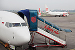 JAKARTA, INDONESIA, MAY 2013:<br /> Lion Air is Indonesia's largest privately run airline, capturing the largest share of the domestic market, May 2013<br /> Jakarta International Airport is the main airport serving the greater Jakarta area on the island of Java, Indonesia.In 2012, the airport was the 9th busiest airport in the world with 57.8 million passengers<br /> <br /> &copy; Giulio Di Sturco for Bloomberg Markets