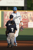 Myrtle Beach Pelicans third baseman Christian Villanueva #14 greets some young fans on the field before a game against the Salem Red Sox at Tickerreturn.com Field at Pelicans Ballpark on May 11, 2012 in Myrtle Beach, South Carolina. Salem defeated Myrtle Beach by the score of 5-3 in 14 innings. (Robert Gurganus/Four Seam Images)