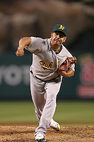 Oakland Athletics pitcher Guillermo Moscoso #52 pitches against the Los Angeles Angels at Angel Stadium on September 24, 2011 in Anaheim,California. Los Angeles defeated Oakland 4-2.(Larry Goren/Four Seam Images)