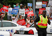 Protesters demonstrate across from the Jefferson Hotel where United States President Barack Obama attended a DNC event, in Washington, D.C. on July 11, 2013.  <br /> Credit: Molly Riley / Pool via CNP