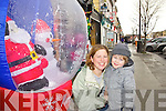 Soaking up the Christmas atmosphere in Castleisland on Friday were Aoife Allen and Micheál Allen from Ballyhar.