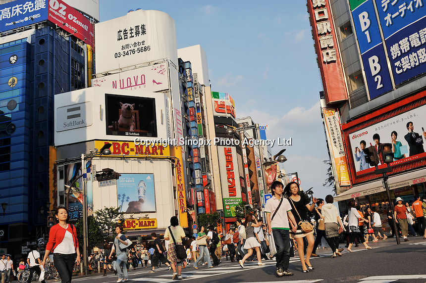 Shoppers in the Shinjuku district of downtown Tokyo, Japan. .