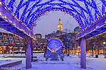A dusting of snow and blue holiday lights in Waterfront Park, Boston, Massachusetts, USA