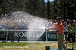 Herm Edwards spraying champagne at the American Century Celebrity Golf Tournament in Lake Tahoe.  I covered this event several times for the local newspaper and the San Francisco Examiner's website.