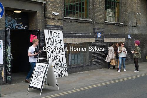 Vintage clothes market signs Brick Lane London E1. Tower Hamlets.