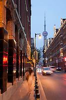 The street alongside Rockbund Art Museum, Oriental TV pearl tower in view. Series of images looking at 'Trendy Shanghai' By Jonathan Browning.