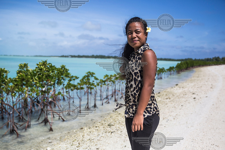 Tinaai Teaua, a member of Kiribati Climate Action Network (KiriCAN), standing in front of mangroves planted near Bonriki International Airport.