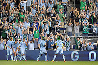C.J Sapong and Kei Kamara (23) put on green hats in celebration of St Patricks Day and Sporting KC's second goal... Sporting Kansas City defeated New England Revolution 3-0 at LIVESTRONG Sporting Park, Kansas City, Kansas.