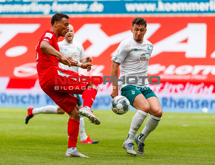Karim Onisiwo (FSV Mainz 05) im Zweikampf mit Milos Veljkovic (SV Werder Bremen), <br /> <br /> Sport: Fussball: 1. Bundesliga:: nphgm001:  Saison 19/20: 33. Spieltag: 1. FSV Mainz 05 vs SV Werder Bremen 20.06.2020<br /> Foto: Neis/Eibner/Pool/via gumzmedia/nordphoto<br /><br />DFB regulations prohibit any use of photographs as image sequences and/or quasi-video.<br />Editorial Use ONLY<br />National and International News Agencies OUT<br />  DFL REGULATIONS PROHIBIT ANY USE OF PHOTOGRAPHS AS IMAGE SEQUENCES AND OR QUASI VIDEO<br /> EDITORIAL USE ONLY<br /> NATIONAL AND INTERNATIONAL NEWS AGENCIES OUT