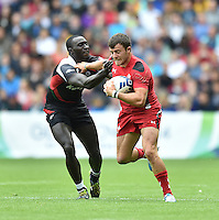 Wales's Luke Morgan evades the tackle of Kenya's Michael David Agevi<br /> <br /> Kenya Vs Wales - men's placing 5-8 match<br /> <br /> Photographer Chris Vaughan/CameraSport<br /> <br /> 20th Commonwealth Games - Day 4 - Sunday 27th July 2014 - Rugby Sevens - Ibrox Stadium - Glasgow - UK<br /> <br /> © CameraSport - 43 Linden Ave. Countesthorpe. Leicester. England. LE8 5PG - Tel: +44 (0) 116 277 4147 - admin@camerasport.com - www.camerasport.com