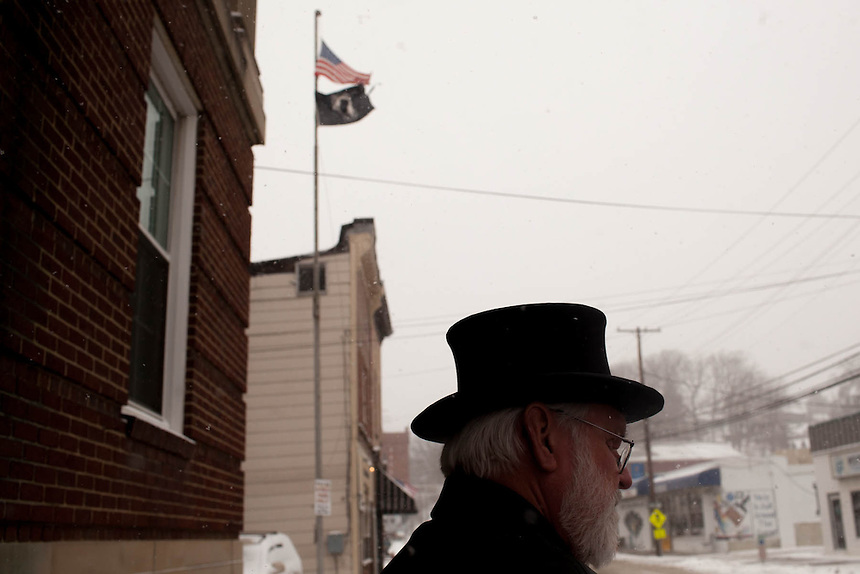 Mike Johnston, an emeritus member of the Inner Circle, now retired, walks across the street in front of the Elk's Lodge in Punxsutawney, PA after a Breakfast with Phil event for the town and visitors on Saturday, January 24, 2014.