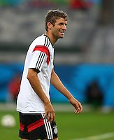 Thomas Muller of Germany laughs during training ahead of tomorrow's semi final vs Brazil