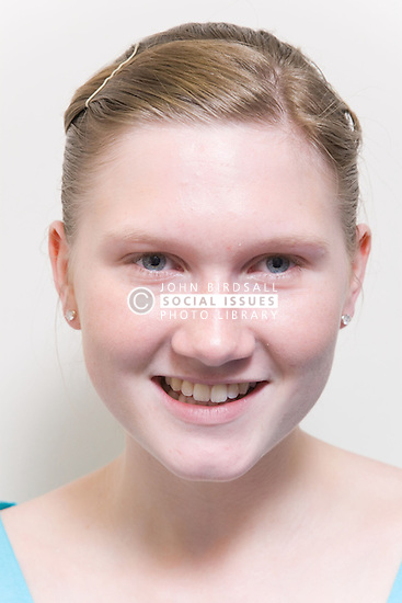 Portrait of a teenage girl smiling,