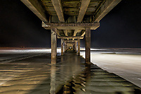We capture this image of the Caldwell Pier after Dark in Port A Texas with a unique look at night.  We have this texas coastal image that we took during the day and at sun rise so we thought why not try it after dark.  So around 2pm we went out to see what we could photograph and the pier had lights so we decided to try a shot here.  You can see where the lights of the pier cast this ghostly look over the waters below.  We had just enough light to see the surf flow over the ripple of sand on the beach as high tide came in with a long exposure, which gave a nice effect we thought. Hope you like our Texas pier beach scene at night.
