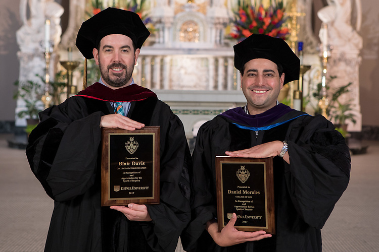 Blair Davis, left, and Daniel Morales were presented with Spirit of Inquiry Awards during DePaul's annual Academic Convocation at the St. Vincent de Paul Parish Church Thursday, Aug. 31, 2017. A. Gabriel Esteban, Ph.D., president of DePaul University, presented the awards to faculty and staff. (DePaul University/Jeff Carrion)